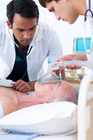 intensive: Multi-ethnic Doctors resuscitating a senior patient  Stock Photo