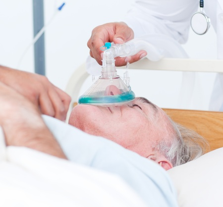 Senior patient receiving oxygen mask  photo