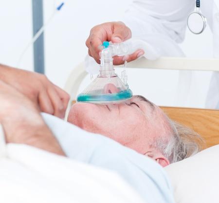 intensive care unit: Senior patient receiving oxygen mask
