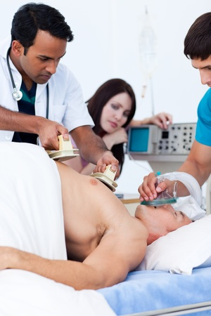 A diverse medical team resuscitating a patient photo