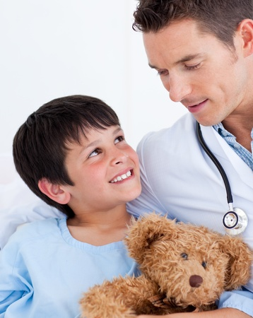 keep watch over: Portrait of a smiling little boy and his doctor Stock Photo