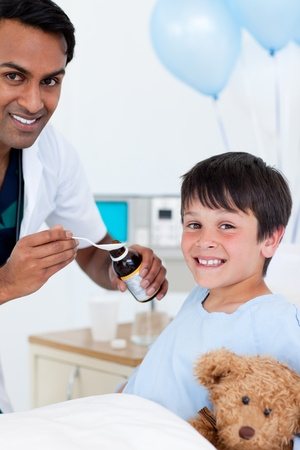 Smiling doctor examining a little boy  photo