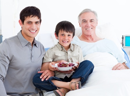 more mature: Father and son visiting grandfather  Stock Photo