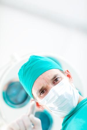 Confident surgeon during a surgery photo