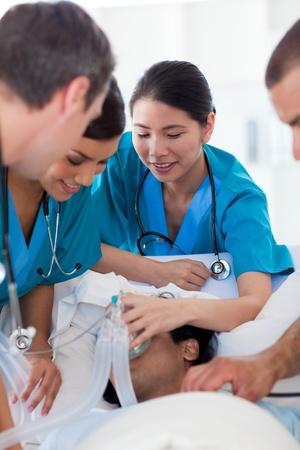 ethic: Multi-ethic doctors resuscitating a patient