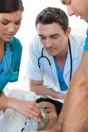Medical team resuscitating a patient Stock Photo - 10095683