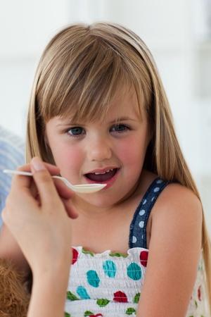 medecine: Close-up of little girl taking medecine