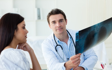 Confident doctors analyzing an x-ray photo
