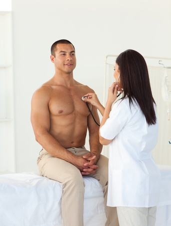 Female doctor checking the pulse of a patient Stock Photo - 10093010