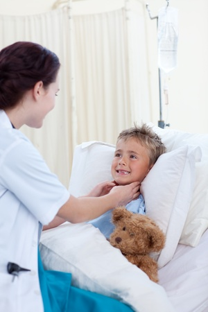 Female doctor checking child throat photo