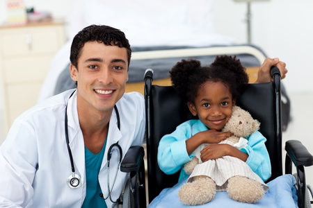 Doctor helping a sick child  photo
