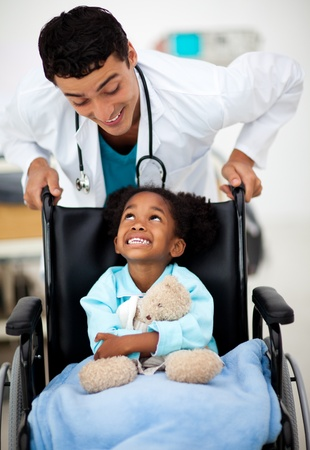 Young Doctor with a sick child  photo