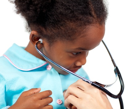 Little girl playing with a stethoscope at a medical check-up  Stock Photo - 10107618