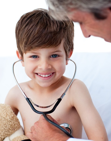 pediatrician: Attentive doctor playing with a little boy