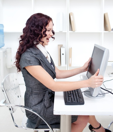 Frustrated businesswoman in office photo