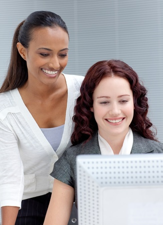 Two business women working on a computer photo