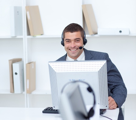 Businessman working in a call center photo