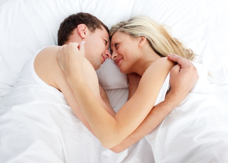 Couple sleeping in bed photo