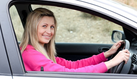 Smiling female driver at the wheel  photo