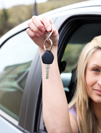 A driver holding a key after bying a new car  photo