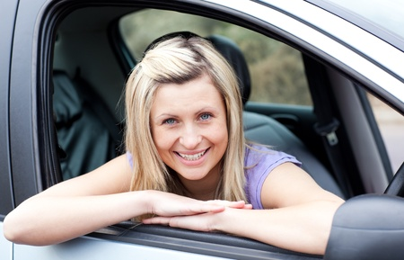 l plate: Portrait of a happy young female driver
