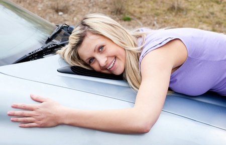 l plate: Jolly young driver huging her new car  Stock Photo