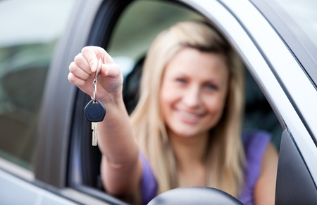 l plate: Young female driver holding a key  Stock Photo
