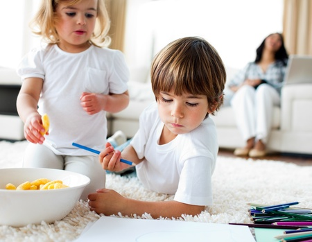 Adorable children eating chips and drawing  photo