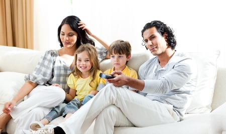 Smiling family watching TV  photo
