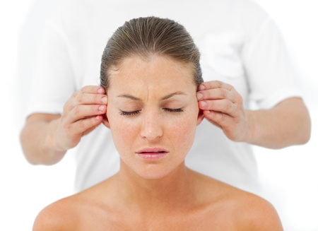 Relaxed woman having a head massage  photo