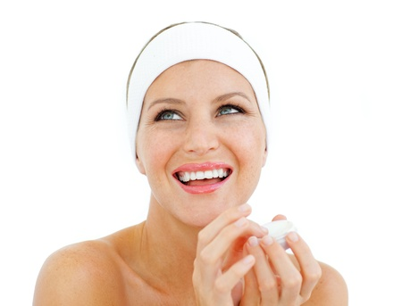 Laughing woman holding a lip balm photo