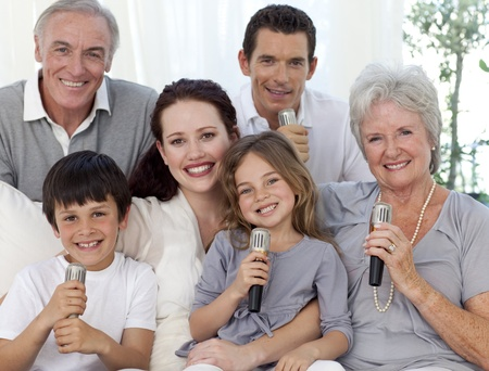 Portrait of family singing in living-room photo