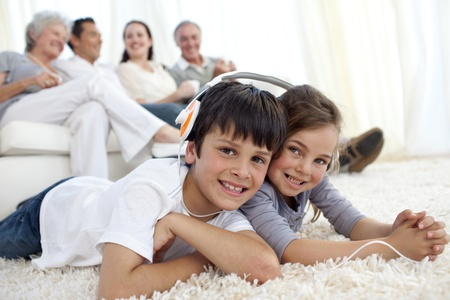 Children on floor listening to the music in living-room Stock Photo - 10095366