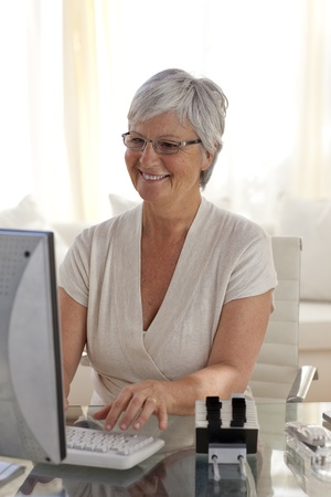 Senior woman working with a computer photo