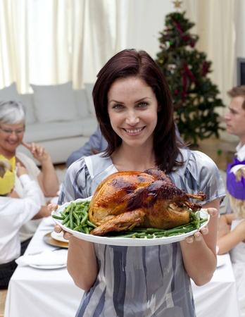 Woman showing to the camera Christmas turkey photo