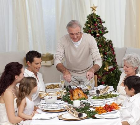 Family having Christmas dinner eating turkey photo