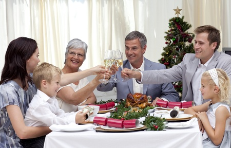 Family drinking a toast in a Christmas dinner photo