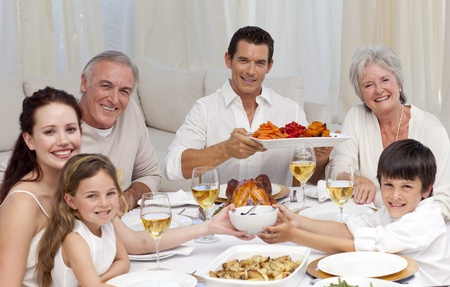 Grandparents, parents and children having a family dinner photo