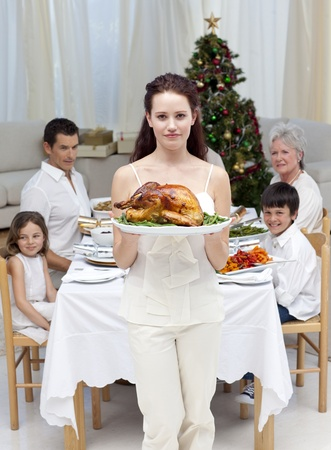 Mother showing turkey for Christmas dinner photo