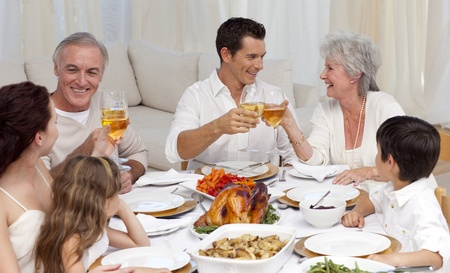 Parents and grandparents tusting with wine in a dinner photo