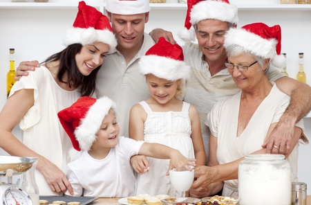 Family baking Christmas cakes and sweets in the kitchen photo