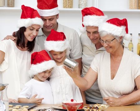 Happy family baking Christmas cakes photo