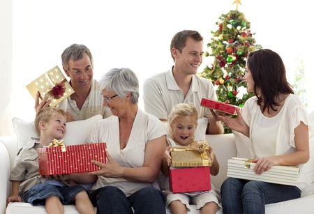 Happy family at home opening Christmas presents Stock Photo - 10108325