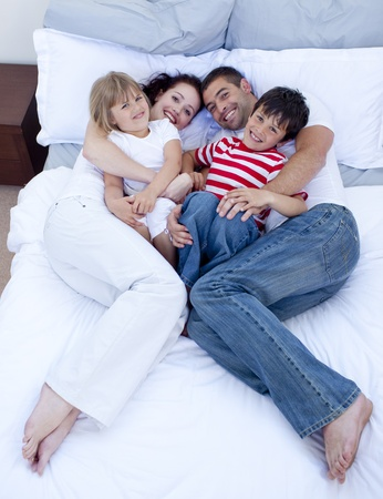 High view of family relaxing in bed photo