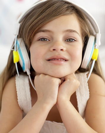 Portrait of little girl listening to the music photo