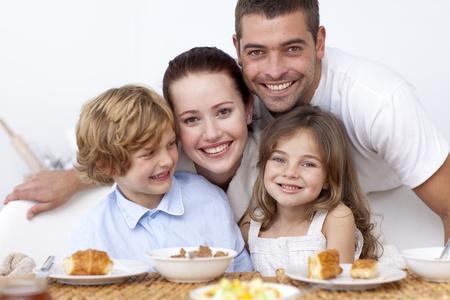 Happy family having breakfast photo