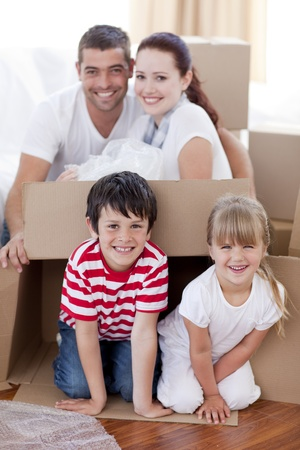 Family moving house playing with boxes Stock Photo