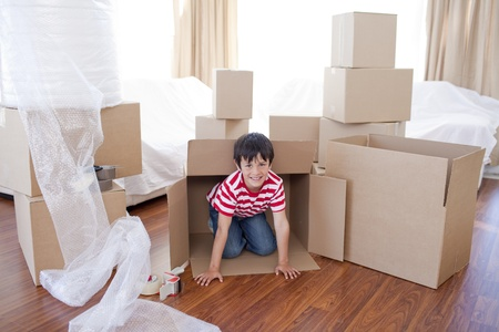 Kid playing with boxes in new house photo