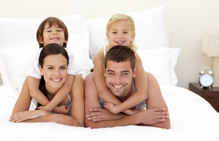 Family having fun in parent's bed Stock Photo - 10093384