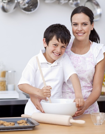 Mother and son baking in the kitchen photo